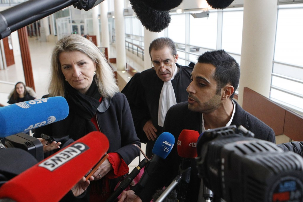 Lawyers for the suspect Marc Goudarzian and Sandrine Parise-Heideiger, left, answer reporters at the hall of justice Tuesday, Feb.13, 2018 in Pontoise