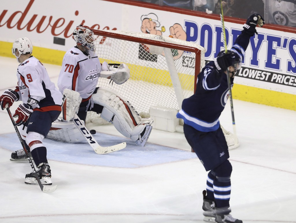 Winnipeg Jets' Tyler Myers (57) celebrates his overtime goal on Washington Capitals goaltender Braden Holtby (70) in an NHL hockey game Tuesday, Feb.