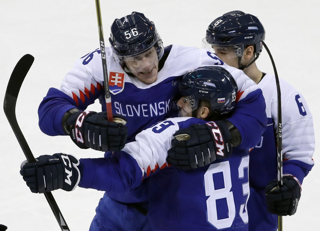 Martin Bakos (83) celebrates with Michal Cajkovsky (56), of Slovakia, after scoring a goal during the first period of the preliminary round of the men