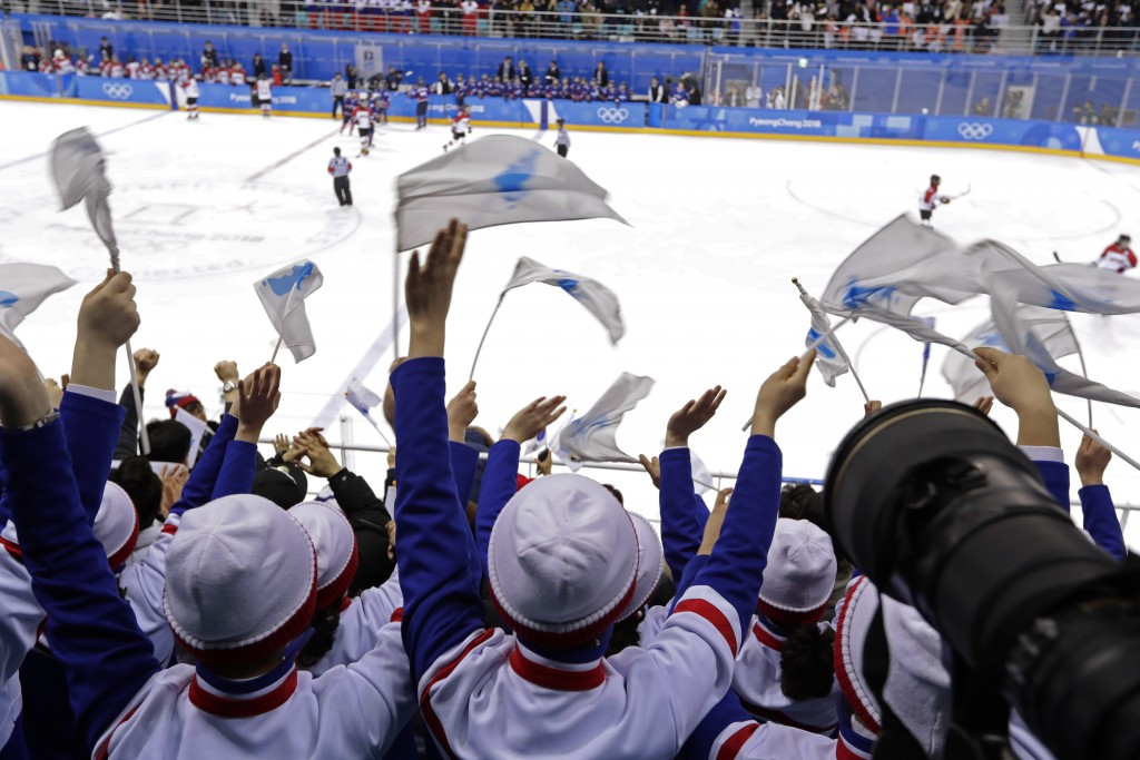 Supporters cheer after a goal against Japan by South Korea's Randi Heesoo Griffin (37), of the combined Koreas team, during the second period of the p