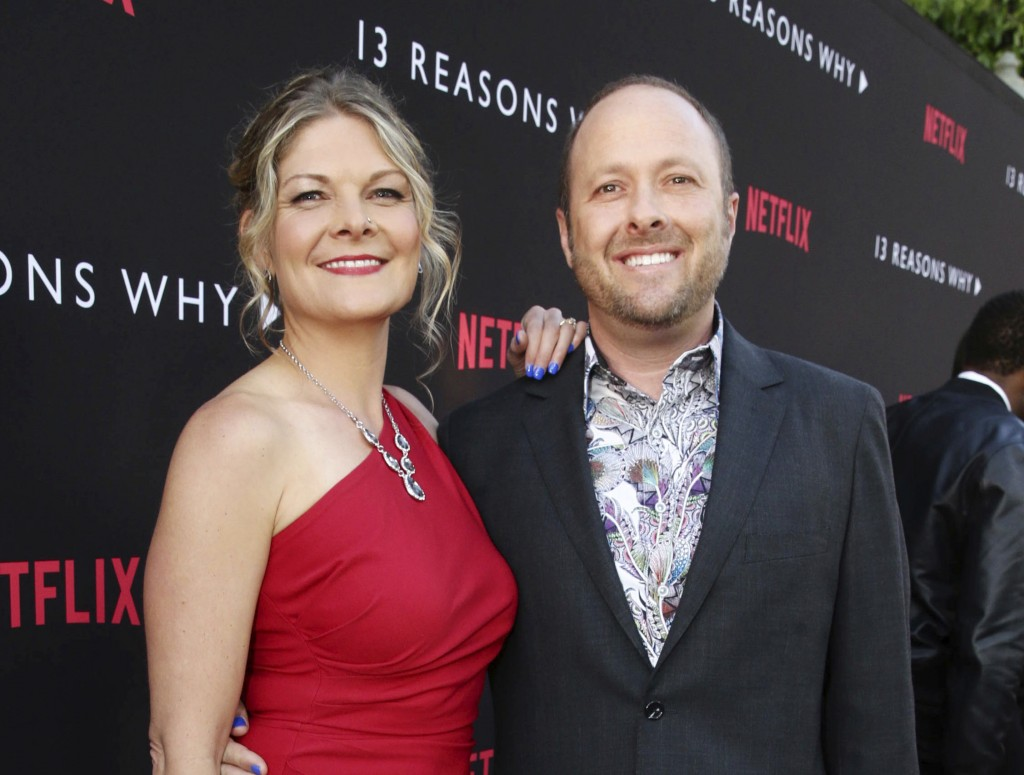 "In this March 30, 2017 photo, Joan Marie and Author Jay Asher appear at the Netflix ""13 Reasons Why"" premiere in Los Angeles. A planned second season"