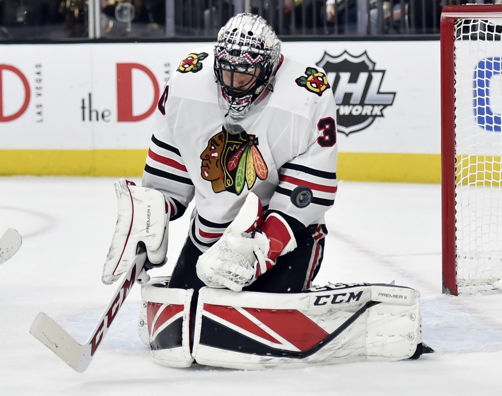 Chicago Blackhawks goalie Jeff Glass defends against the Vegas Golden Knights during the second period of an NHL hockey game Tuesday, Feb. 13, 2018, i