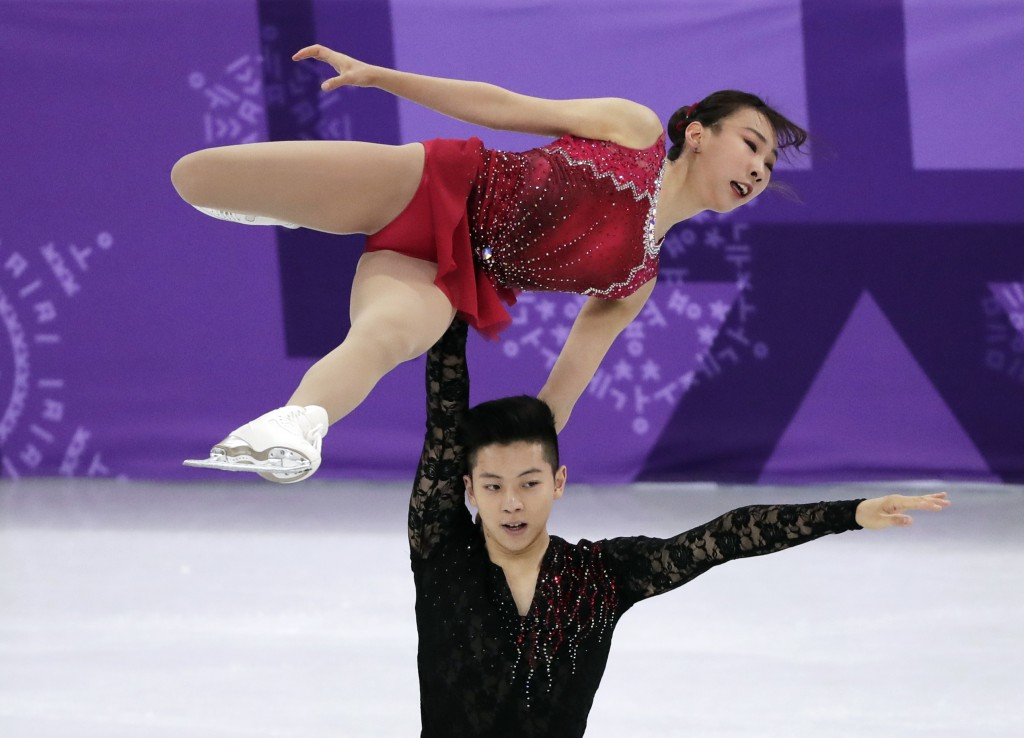 Kim Kyuen and Chan Alex Kang of South Korea perform in the pair figure skating short program in the Gangneung Ice Arena at the 2018 Winter Olympics in