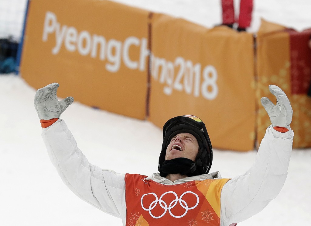 Shaun White, of the United States, celebrates winning gold after his run during the men's halfpipe finals at Phoenix Snow Park at the 2018 Winter Olym