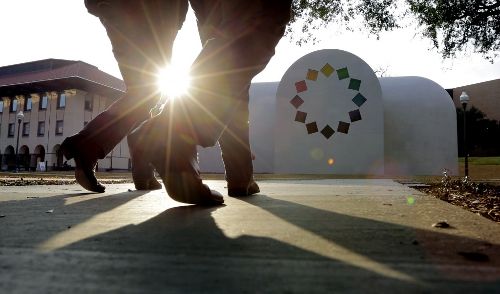 """In this Monday, Feb. 12, 2018, photo, pedestrians pass Ellsworth Kelly's """"Austin"""" at the Blanton Museum of Art, in Austin, Texas. The exhibit, a 2,715"""