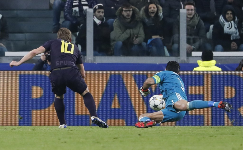 Tottenham's Harry Kane scores his side's opening goal during the Champions League, round of 16, first-leg soccer match between Juventus and Tottenham