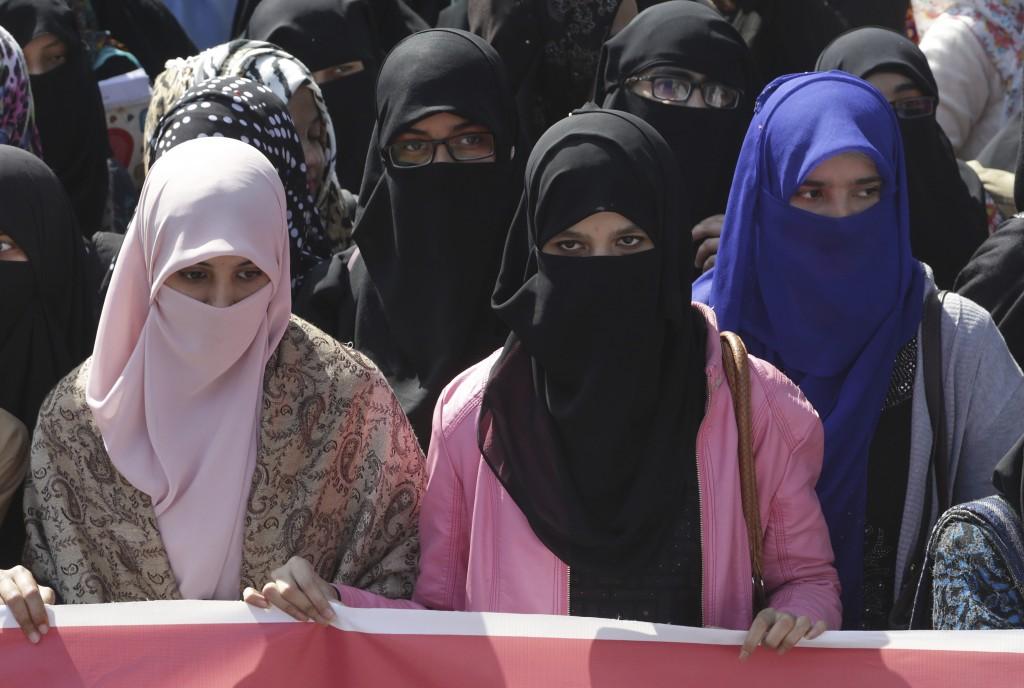Students of Punjab University rally to condemn the Valentine's celebration in Lahore, Pakistan, Wednesday, Feb. 14, 2018. Pakistan's media regulatory