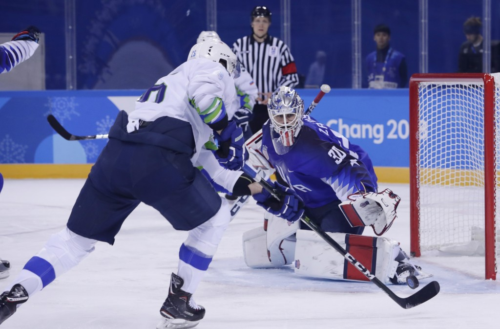 Goaltender Ryan Zapolski (30), of the United States, stops a shot on the goal by Jan Urbas (26), of Slovenia, during the first period of the prelimina