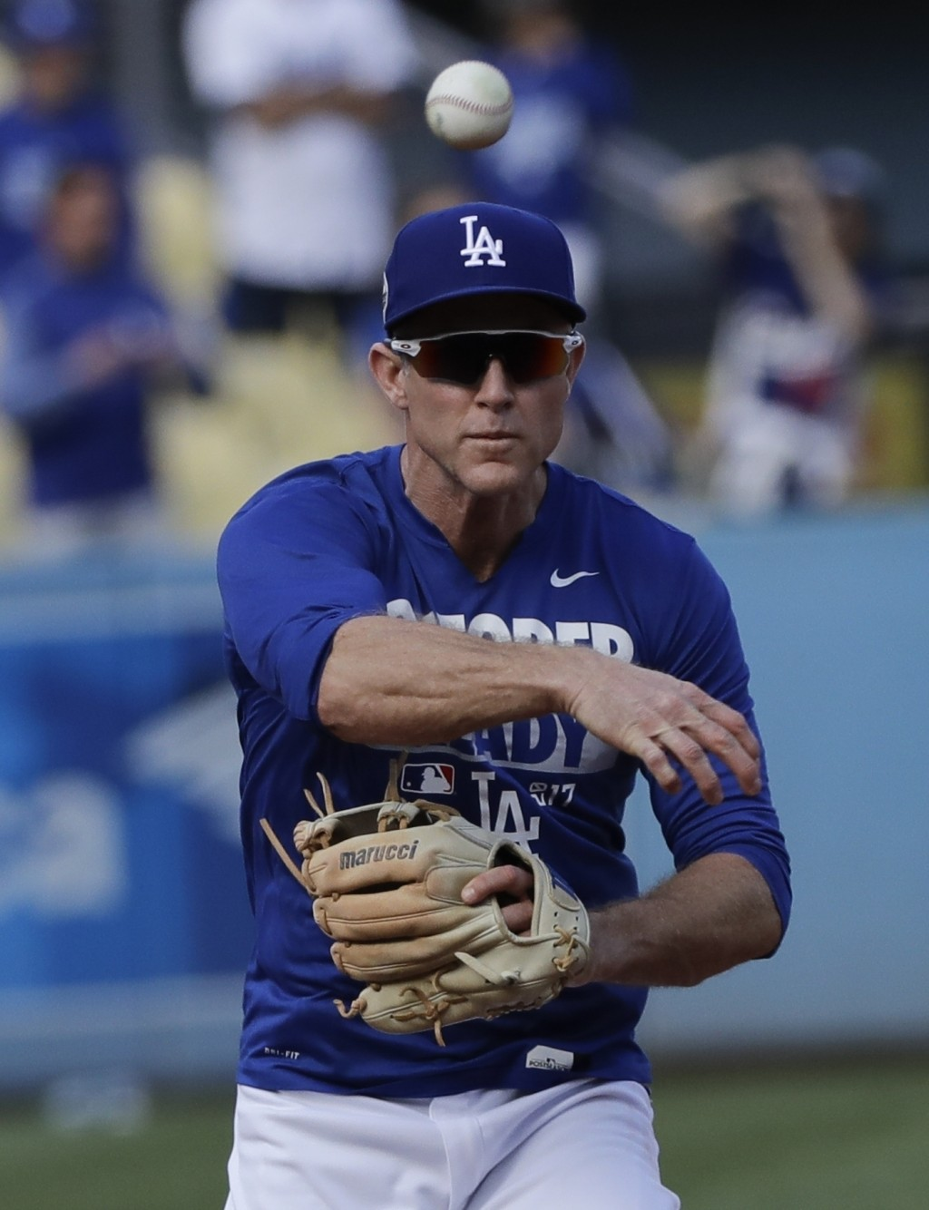 FILE - This Nov. 1, 2017 file photo shows Los Angeles Dodgers' Chase Utley warming up before Game 7 of baseball's World Series against the Houston Ast