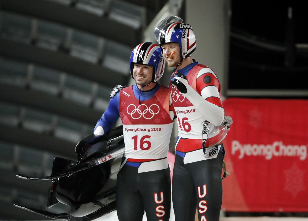 Justin Krewson and Andrew Sherk of the United States react after their final run during the men's doubles luge final at the 2018 Winter Olympics in Py