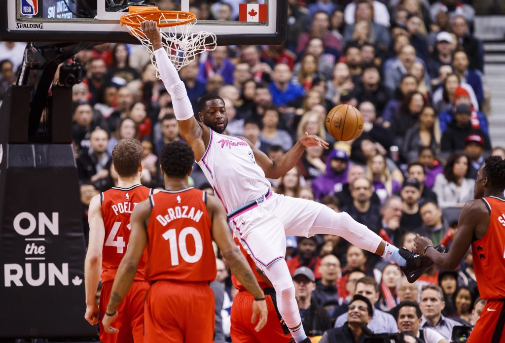 Miami Heat guard Dwyane Wade goes up for a slam dunk against the Toronto Raptors during the first half of an NBA basketball game, Tuesday, Feb. 13, 20