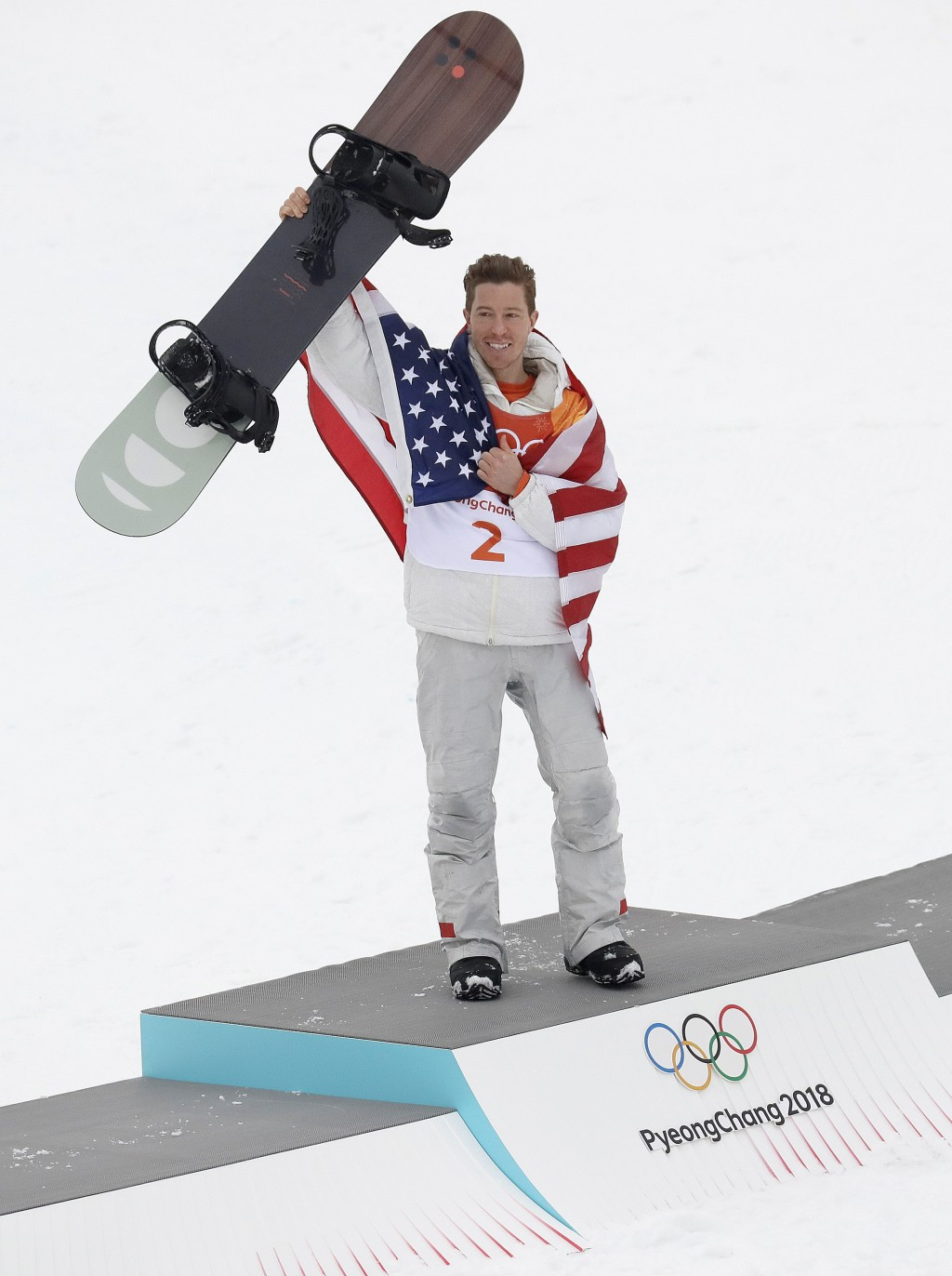 Gold medal winner Shaun White, of the United States, celebrates after the men's halfpipe finals at Phoenix Snow Park at the 2018 Winter Olympics in Py