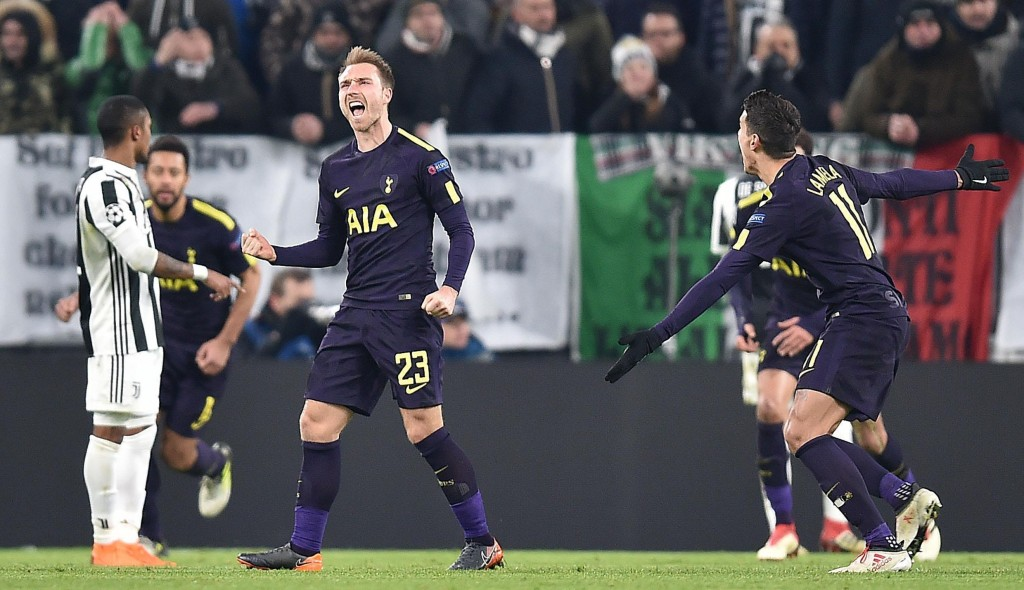 Tottenham's Christian Eriksen celebrates after scoring during the Champions League, round of 16 first-leg soccer match between Juventus and Tottenham