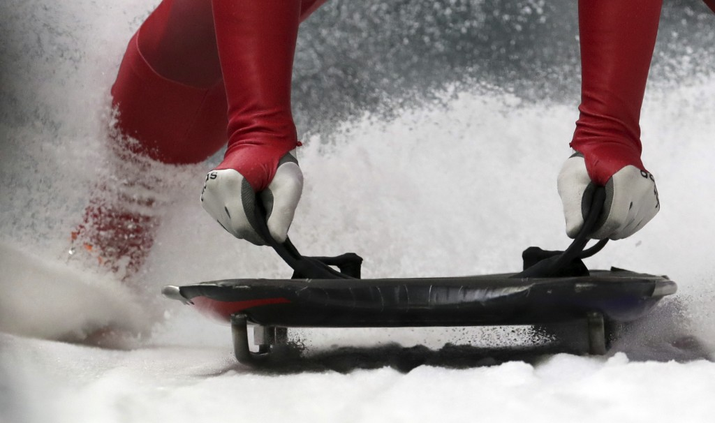 Jisoo Kim of South Korea brakes in the finish area during the men's skeleton training at the 2018 Winter Olympics in Pyeongchang, South Korea, Wednesd