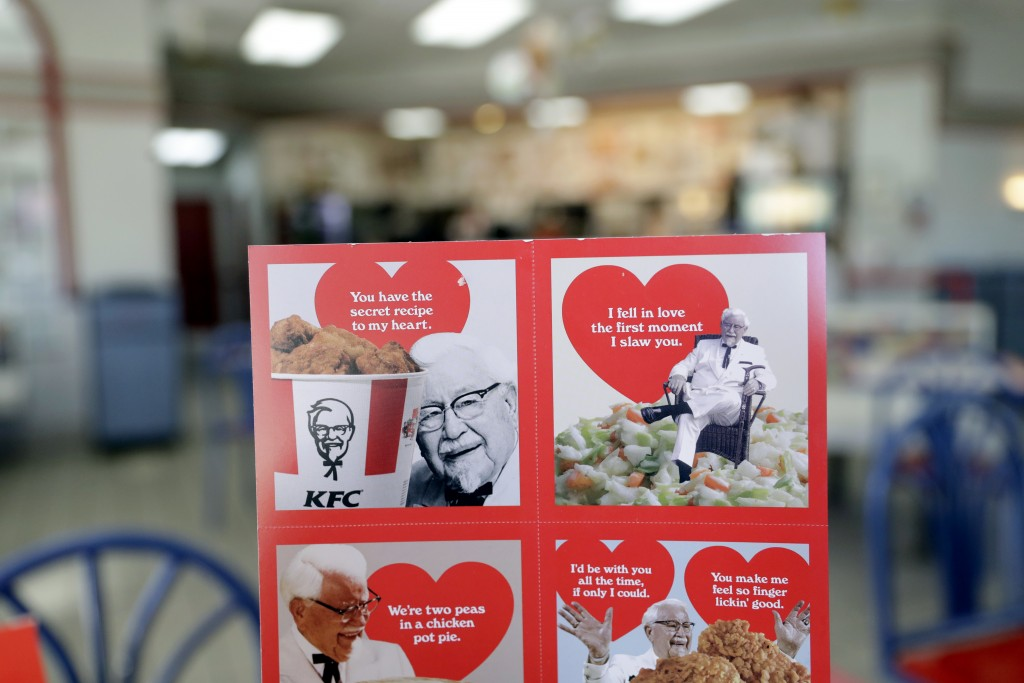 Valentine's Day scratch-and-sniff cards, which give off a fried chicken aroma, are seen at a KFC, Tuesday, Feb. 13, 2018, in Santa Clara, Calif. In an