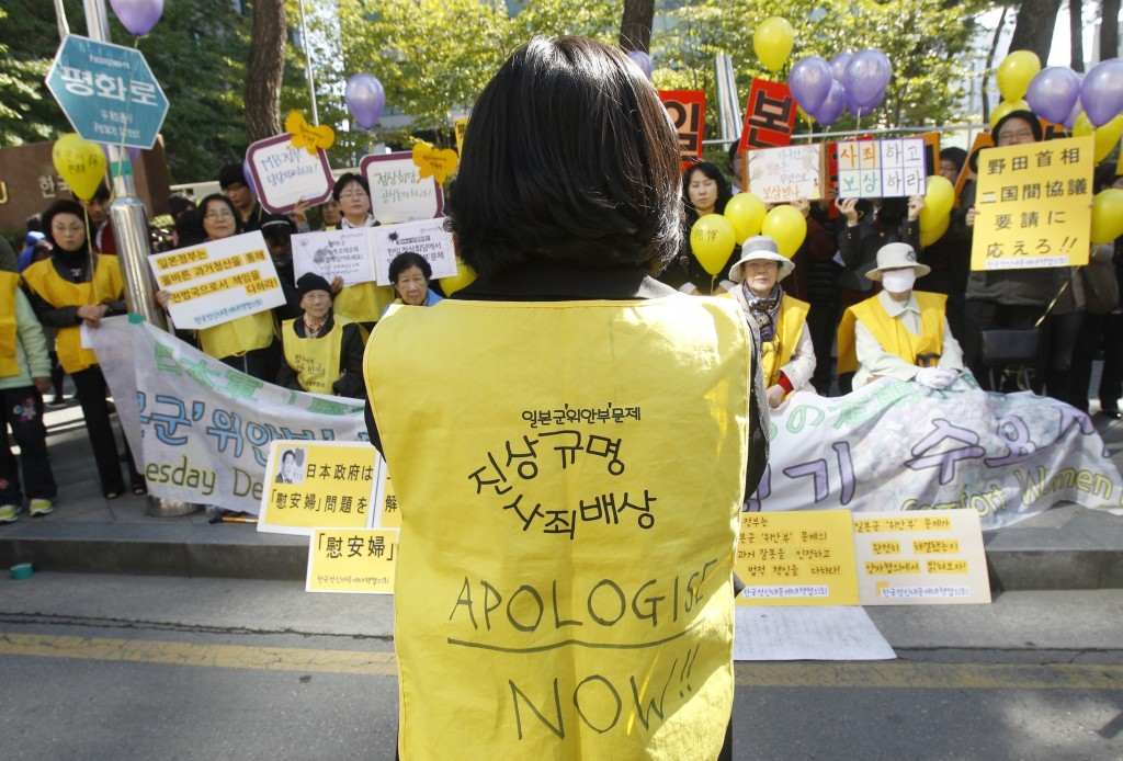 FILE - In this Oct. 19, 2011 file photo, former South Korean comfort women who were forced to serve for the Japanese Army as sexual slaves during Worl