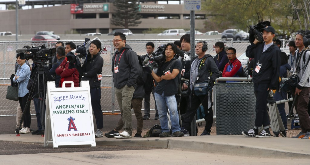 Members of the media await the arrival of Los Angeles Angels baseball player Shohei Ohtani at Tempe Diablo Stadium on Tuesday, Feb. 13, 2018, in Tempe