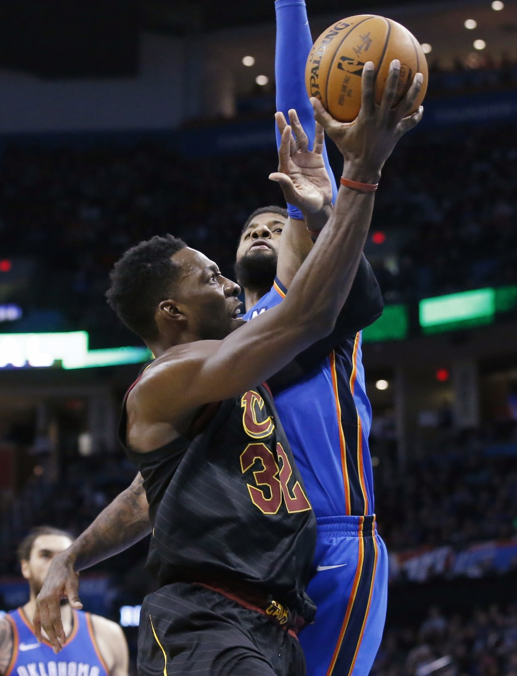 Cleveland Cavaliers forward Jeff Green (32) is fouled by Oklahoma City Thunder forward Paul George during the first half of an NBA basketball game in