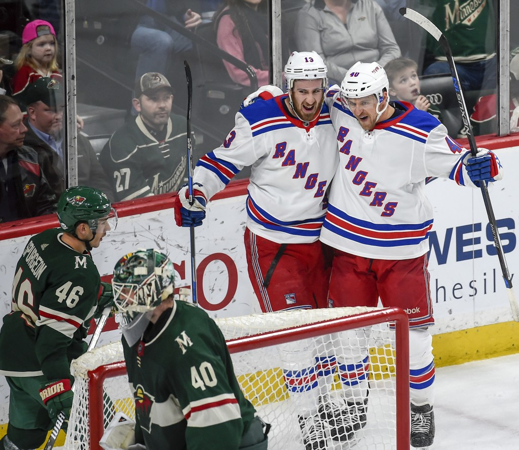 New York Rangers right wing Kevin Hayes, second from right, and right wing Michael Grabner, of Austria, celebrate after Hayes scored a goal as Minneso