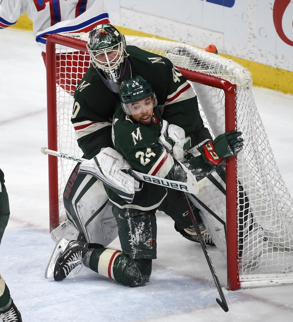 Minnesota Wild defenseman Matt Dumba (24) collides with goalie Devan Dubnyk (40) during the third period of the team's NHL hockey game against the New