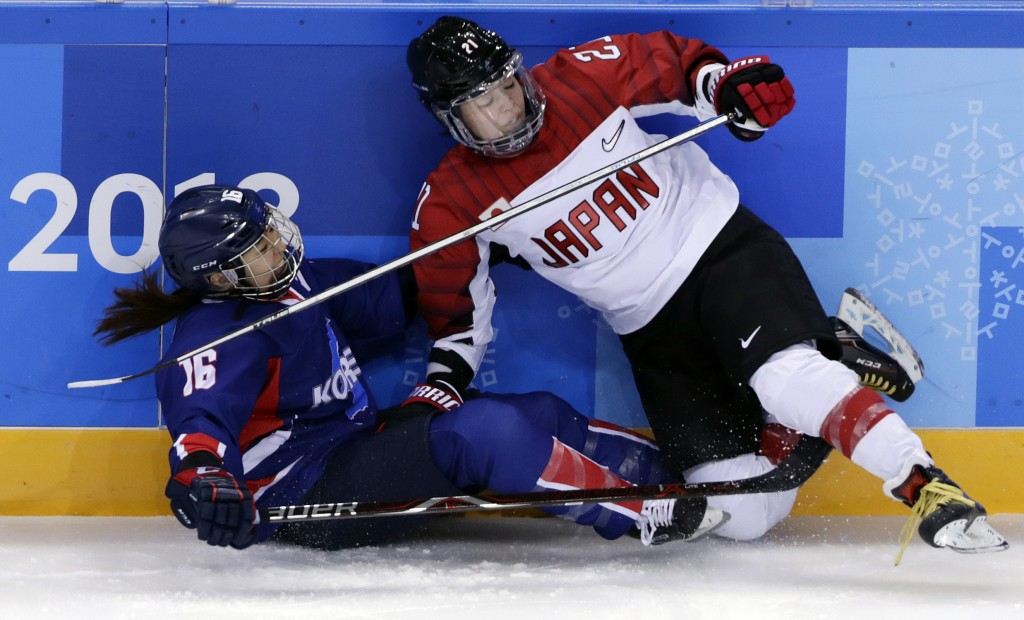 Hanae Kubo (21), of Japan, collides with South Korea's Jo Su Sie (16), of the combined Koreas team, during the second period of the preliminary round