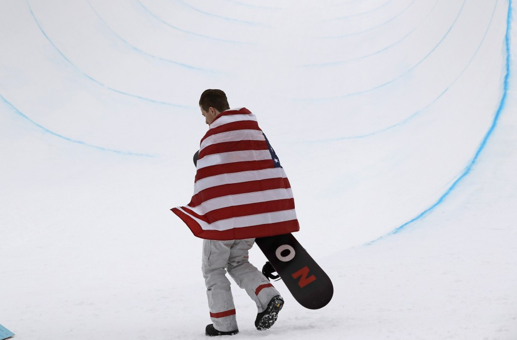 Gold medal winner Shaun White, of the United States, celebrates after finishing his run during the men's halfpipe finals at Phoenix Snow Park at the 2