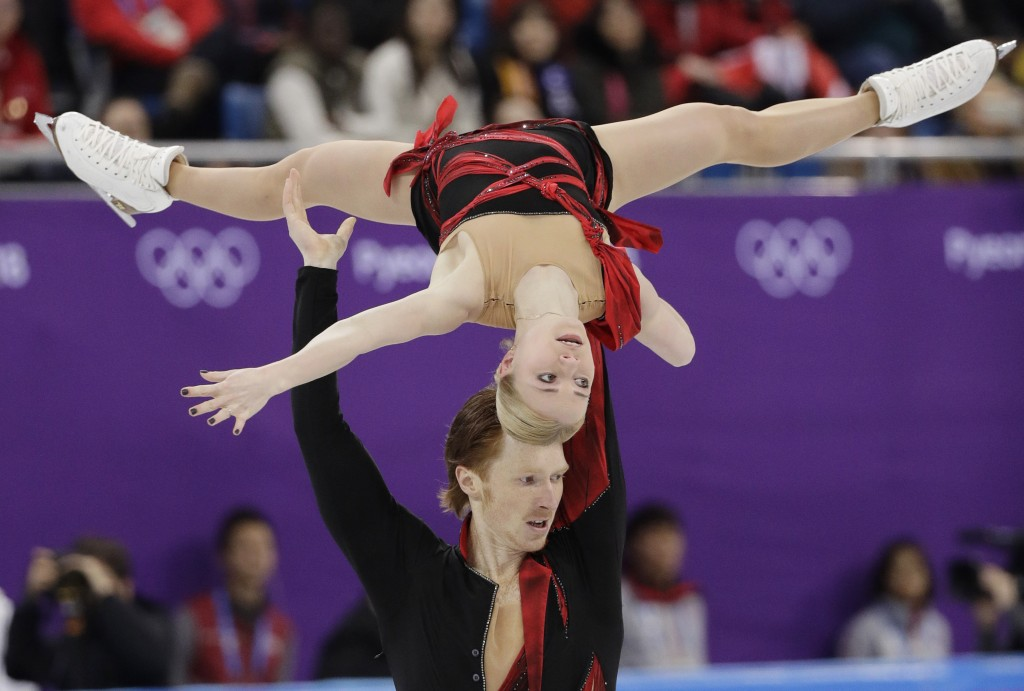 Evgenia Tarasova and Vladimir Morozov of the Olympic Athletes of Russia perform in the pair figure skating short program in the Gangneung Ice Arena at