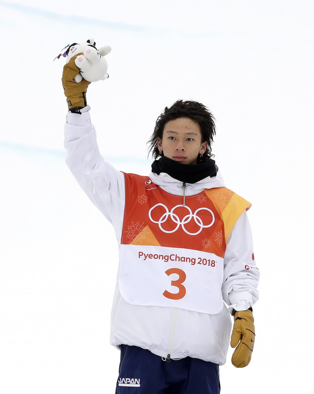 Silver medal winner Ayumu Hirano, of Japan, celebrates after the men's halfpipe finals at Phoenix Snow Park at the 2018 Winter Olympics in Pyeongchang