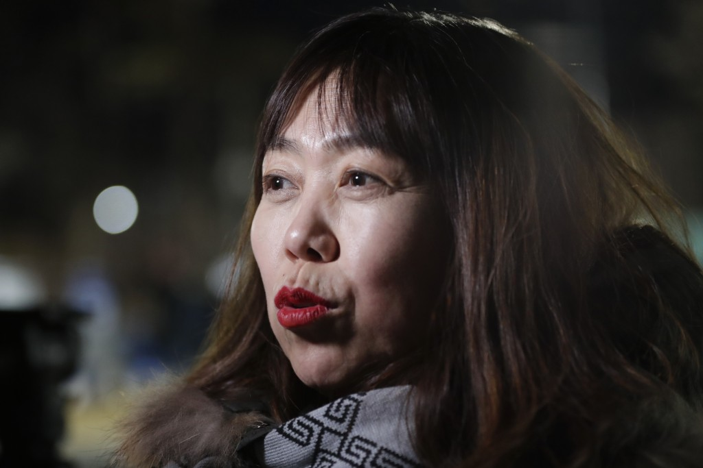 In a photo taken Monday, Feb. 12, 2018, Woo Hee-jun, mother of South Korean player Han Dohee, talks to The Associated Press while arriving at the Kwan