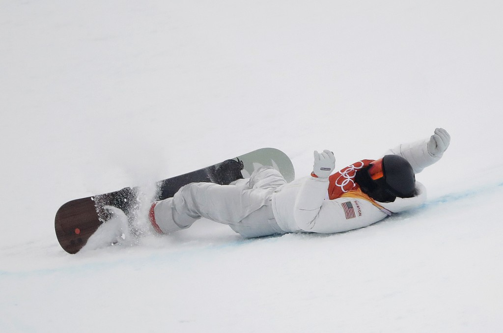Shaun White, of the United States, crashes during the men's halfpipe finals at Phoenix Snow Park at the 2018 Winter Olympics in Pyeongchang, South Kor