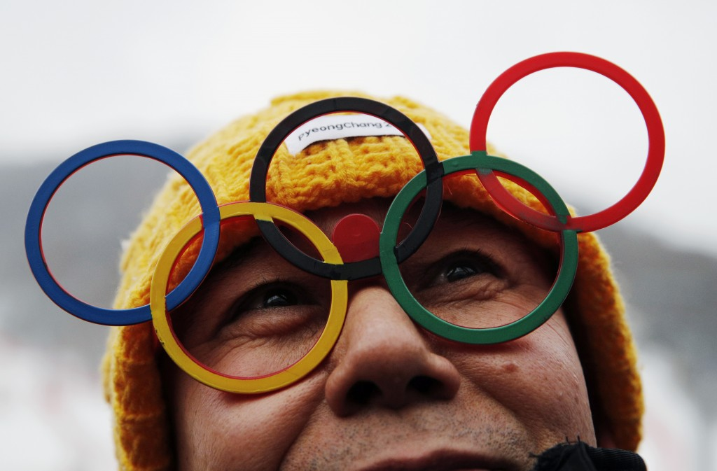 A spectator wears glasses of the Olympic rings at the women's slalom at Yongpyong Alpine Center at the 2018 Winter Olympics in Pyeongchang, South Kore