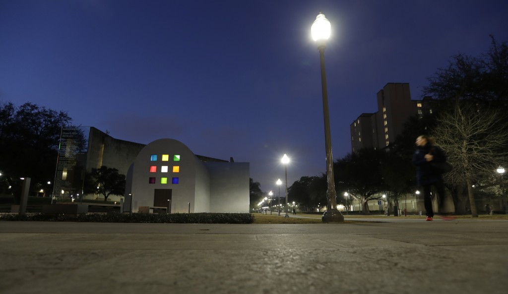 """In this Monday, Feb. 12, 2018, photo, a woman passes Ellsworth Kelly's """"Austin"""" at the Blanton Museum of Art, in Austin, Texas. The exhibit, a 2,715-s"""