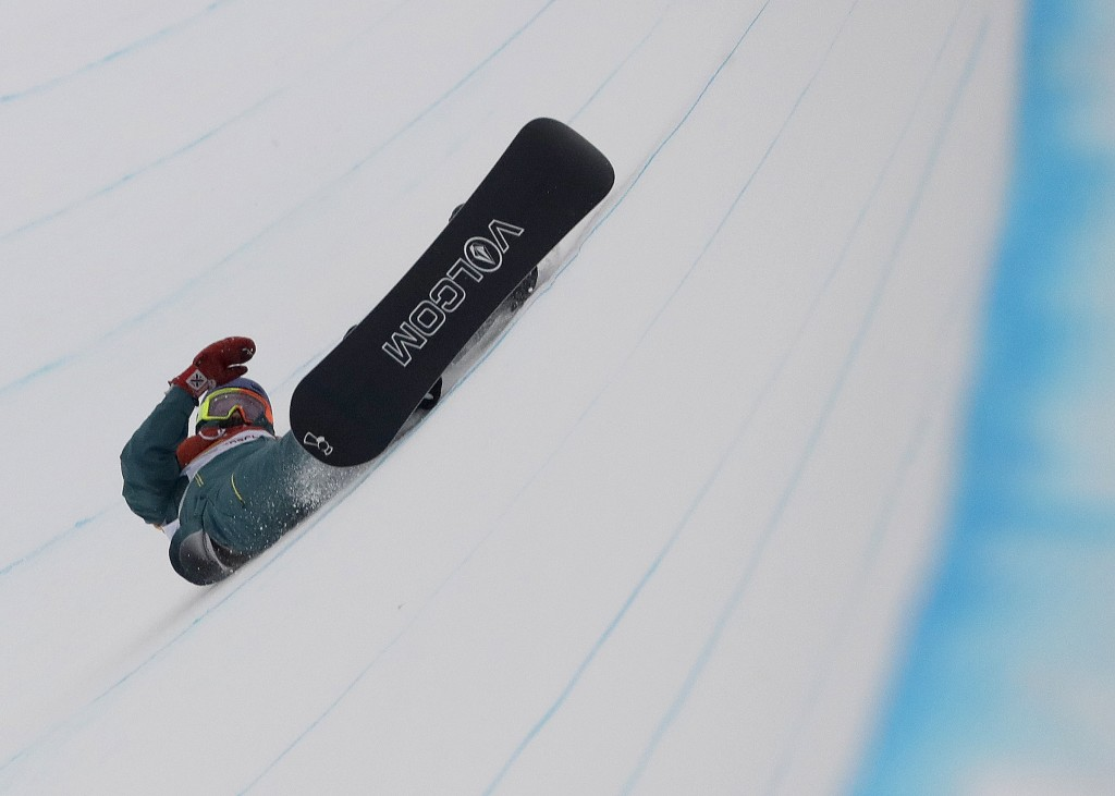 Scotty James, of Australia, crashes during the men's halfpipe finals at Phoenix Snow Park at the 2018 Winter Olympics in Pyeongchang, South Korea, Wed