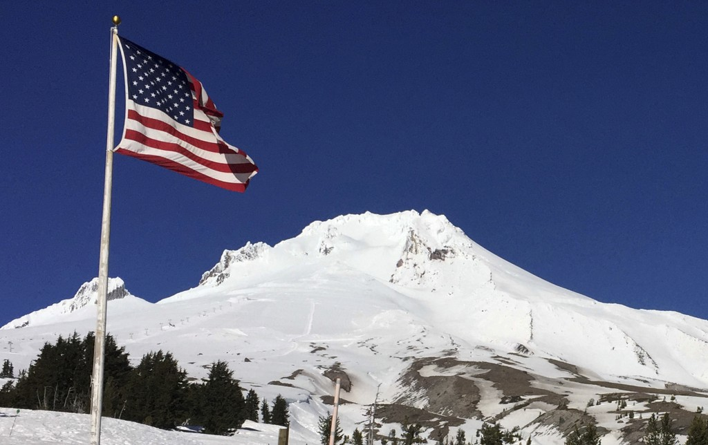 Oregon's Mount Hood is seen from Timberline Lodge on the south side of the mountain, Tuesday, Feb. 13, 2018. Authorities say a climber who fell up to