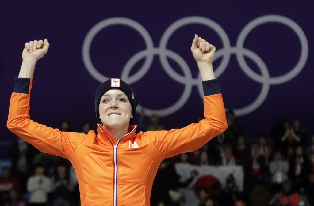 Gold medallist Jorien ter Mors of The Netherlands celebrates on the podium after the women's 1,000 meters speedskating race at the Gangneung Oval at t