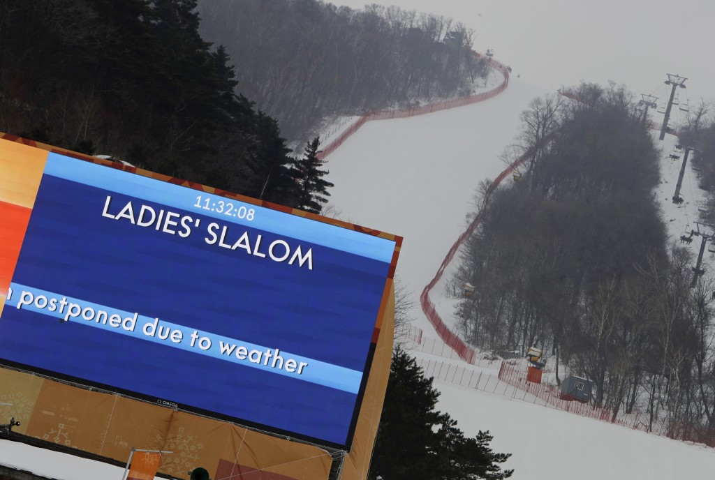 A sign says that the women's slalom has been canceled due to weather at Yongpyong alpine center at the 2018 Winter Olympics in Pyeongchang, South Kore