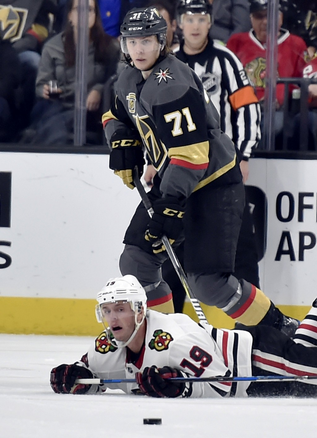 Chicago Blackhawks center Jonathan Toews (19) falls to the ice as Vegas Golden Knights center William Karlsson skates next to him during the second pe