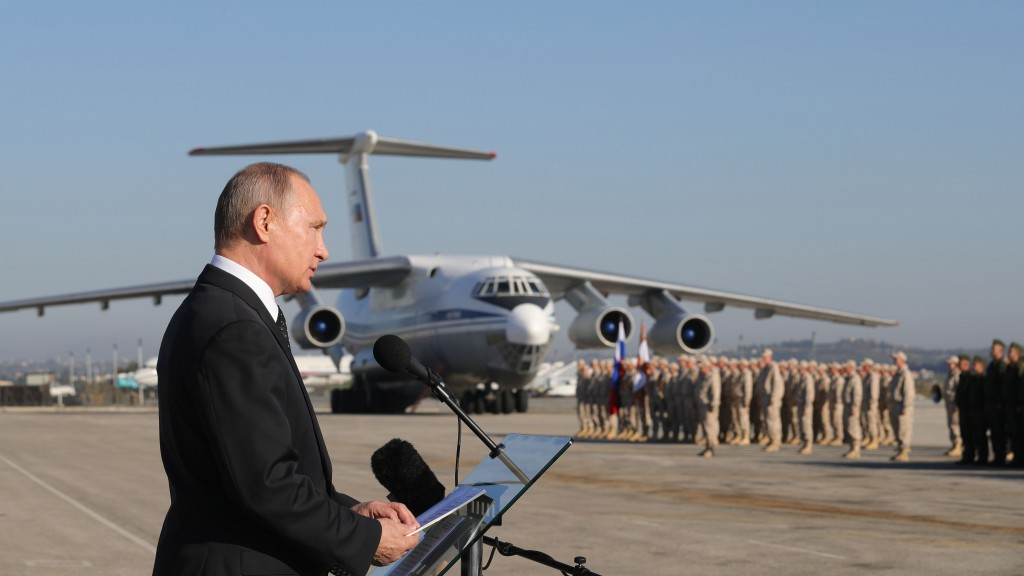 FILE - In this file photo taken on Tuesday, Dec. 12, 2017, Russian President Vladimir Putin addresses the troops at the Hemeimeem air base in Syria. S