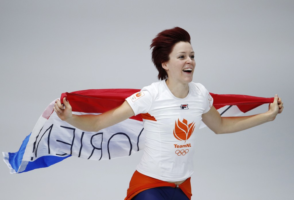 Gold medallist Jorien ter Mors of The Netherlands celebrates with the national flag after the women's 1,000 meters speedskating race at the Gangneung