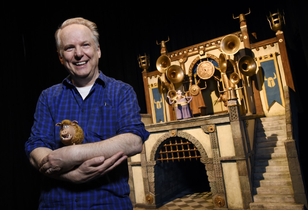 "In this Feb. 8, 2018 photo, Nick Park, director of the stop-motion animated film ""Early Man,"" and the voice of the wild boar character Hognob, cradles"