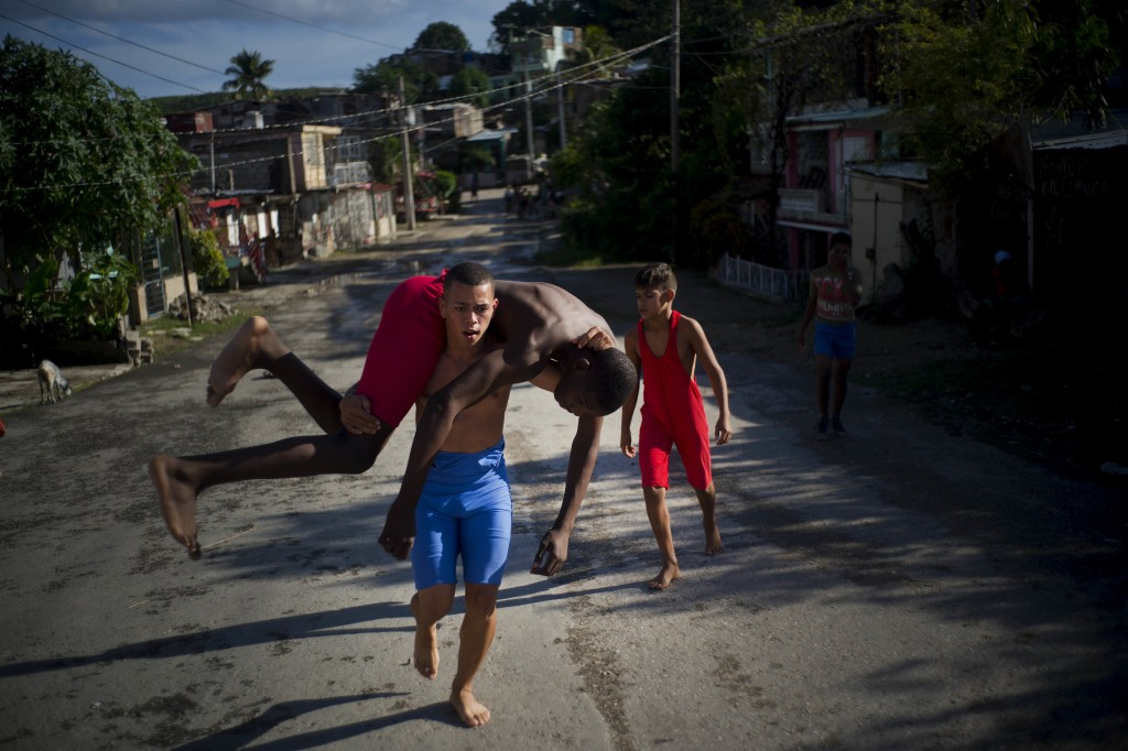 """In this Jan. 22, 2018 photo, young wrestlers train in the street during the week-long student wrestling championship coined """"The truth of my neighborh"""