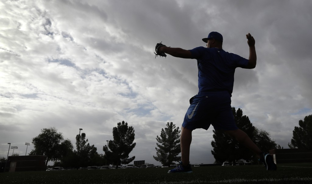 Kansas City Royals pitcher Wily Peralta warms up during a baseball spring training workout, Tuesday, Feb. 13, 2018, in Surprise, Ariz. (AP Photo/Charl