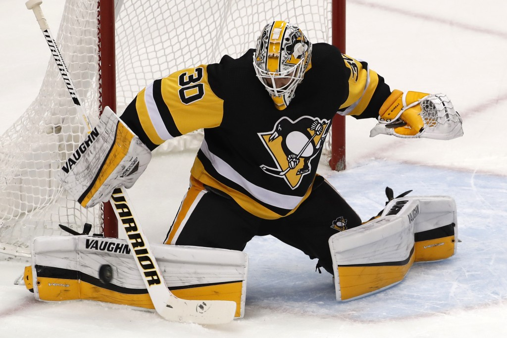 Pittsburgh Penguins goaltender Matt Murray blocks a shot during the first period of the team's NHL hockey game against the Ottawa Senators in Pittsbur