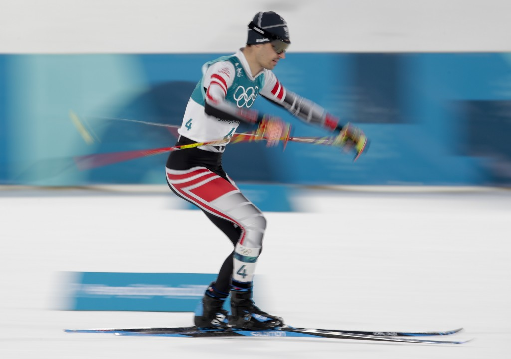 Lukas Klapfer, of Austria, competes during the 10km cross-country skiing portion of the nordic combined event at the 2018 Winter Olympics in Pyeongcha