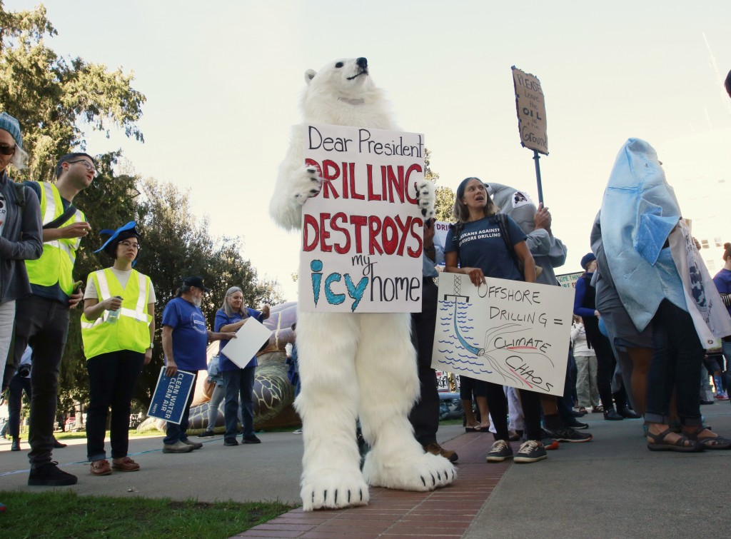 FILE - In this Thursday, Feb. 8, 2018 file photo, a protester dressed like a polar bear joins other protesters against oil drilling off the California