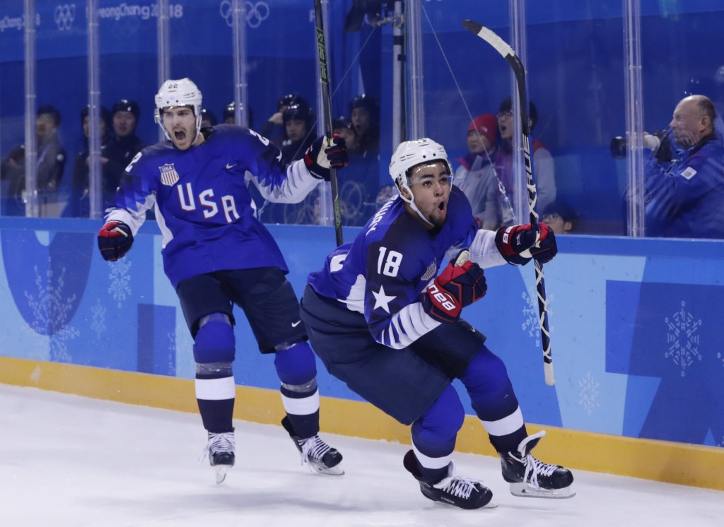 Jordan Greenway (18), of the United States, celebrates with teammate Bobby Sanguinetti (22) after scoring a goal during the second period of the preli