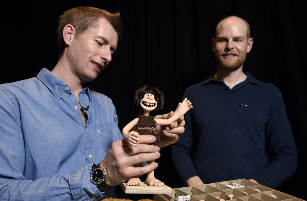 "Merlin Crossingham, left, and Will Becher, animation directors for the stop-motion animated film ""Early Man,"" demonstrate a waving motion for the pupp"