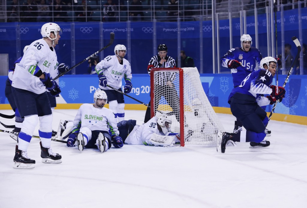 Jordan Greenway (18), of the United States, celebrates after scoring a goal as goaltender Gasper Kroselj (32), of Slovenia, Blaz Gregorc (15) and Jan