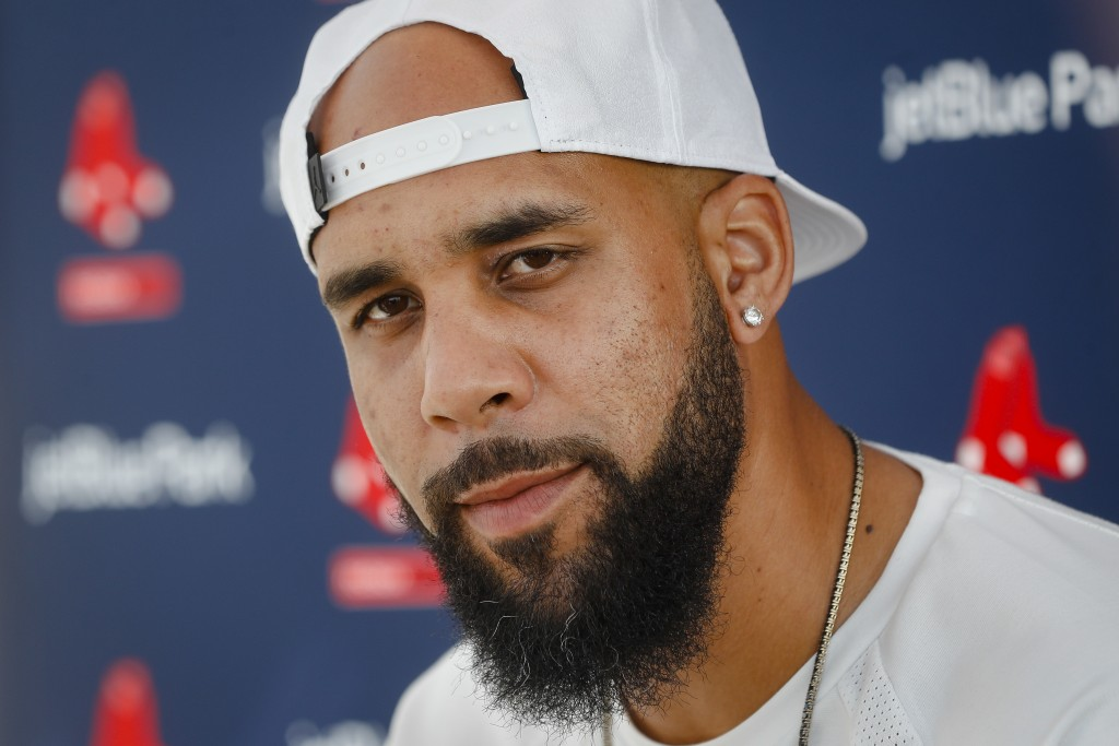 Boston Red Sox pitcher David Price speaks to the media at baseball spring training, Tuesday, Feb. 13, 2018, in Fort Myers, Fla. (AP Photo/John Minchil