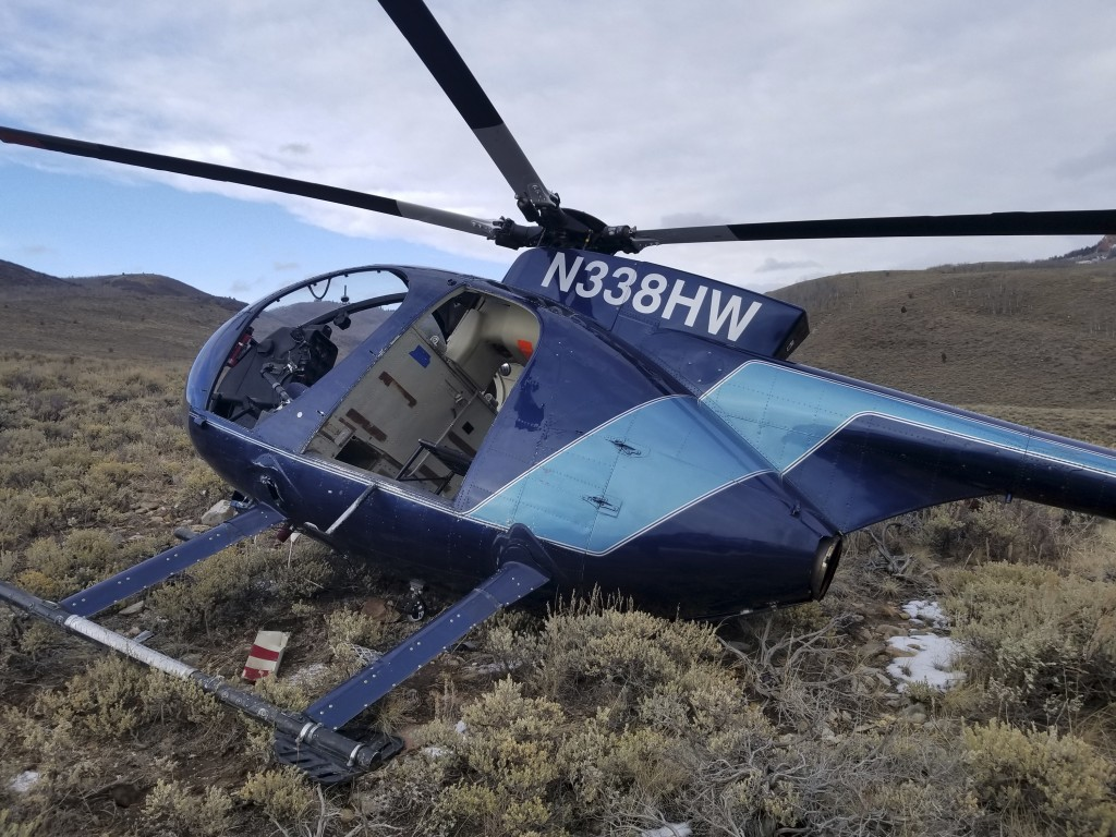In this photo taken Monday, Feb. 12, 2018, and provided by the Wasatch County Sheriff's Office is a research helicopter that was brought down by a lea